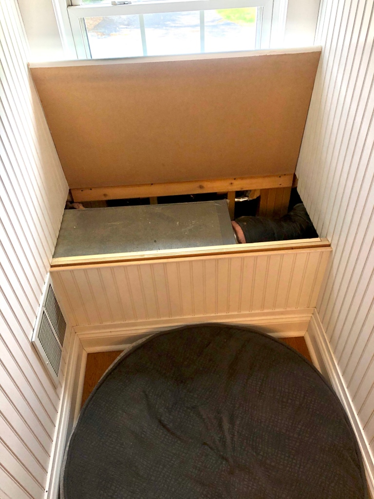 air handler & duct work inside of the bench
